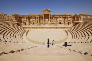Tourists take pictures at the ancient theater in the historical city of Palmyra, April 18, 2008. REUTERS/Omar Sanadiki